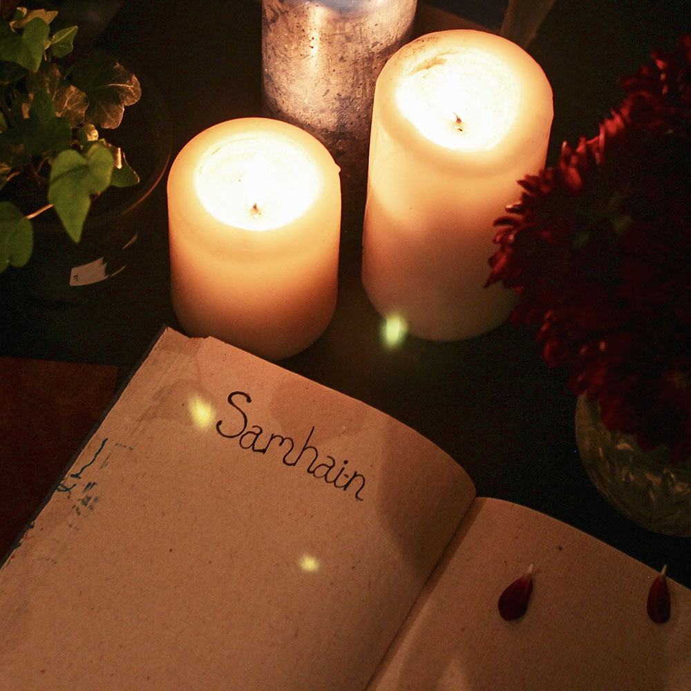 Samhain journal page with three glowing candles