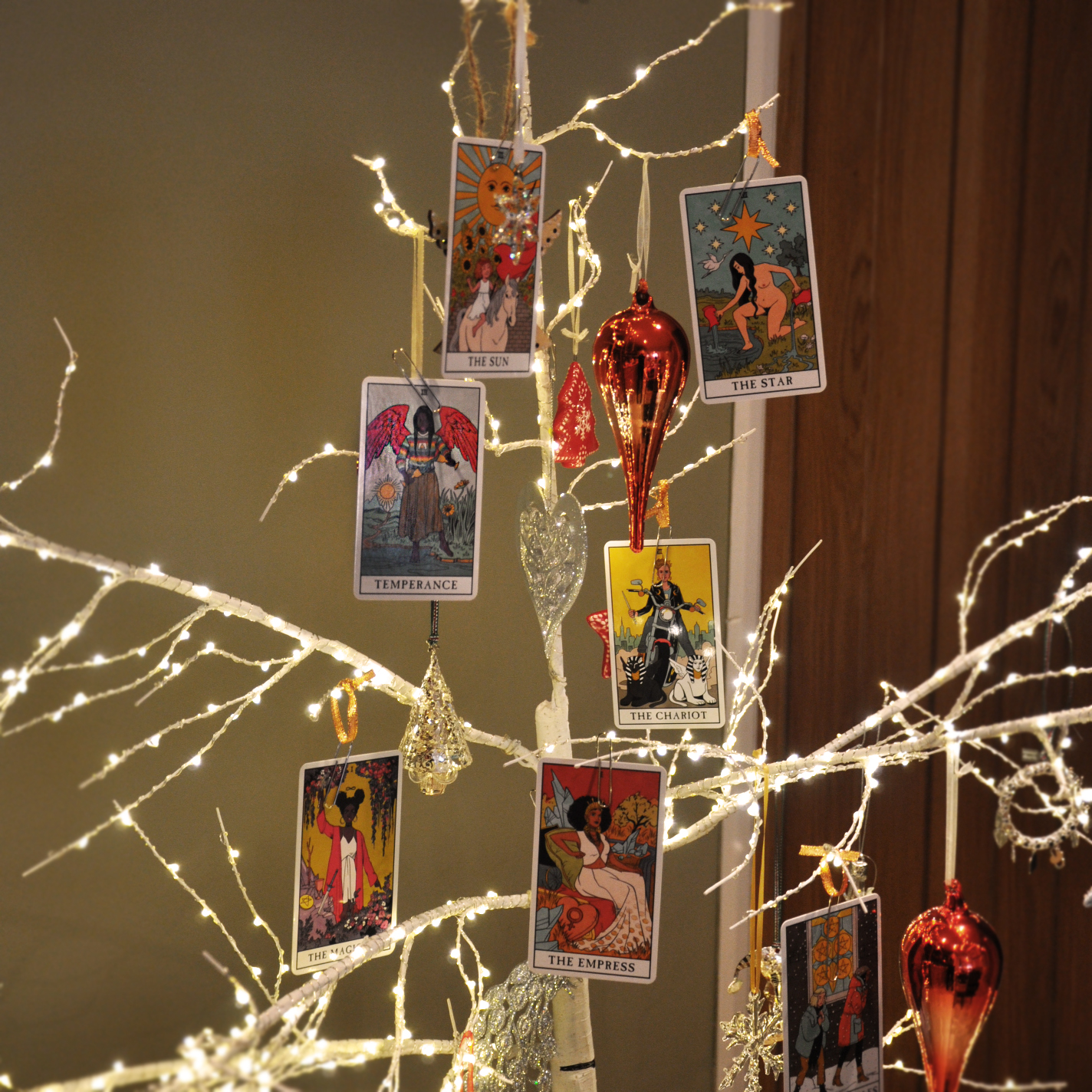 A Christmas Tree with tarot card ornaments from the Modern Witch Tarot deck