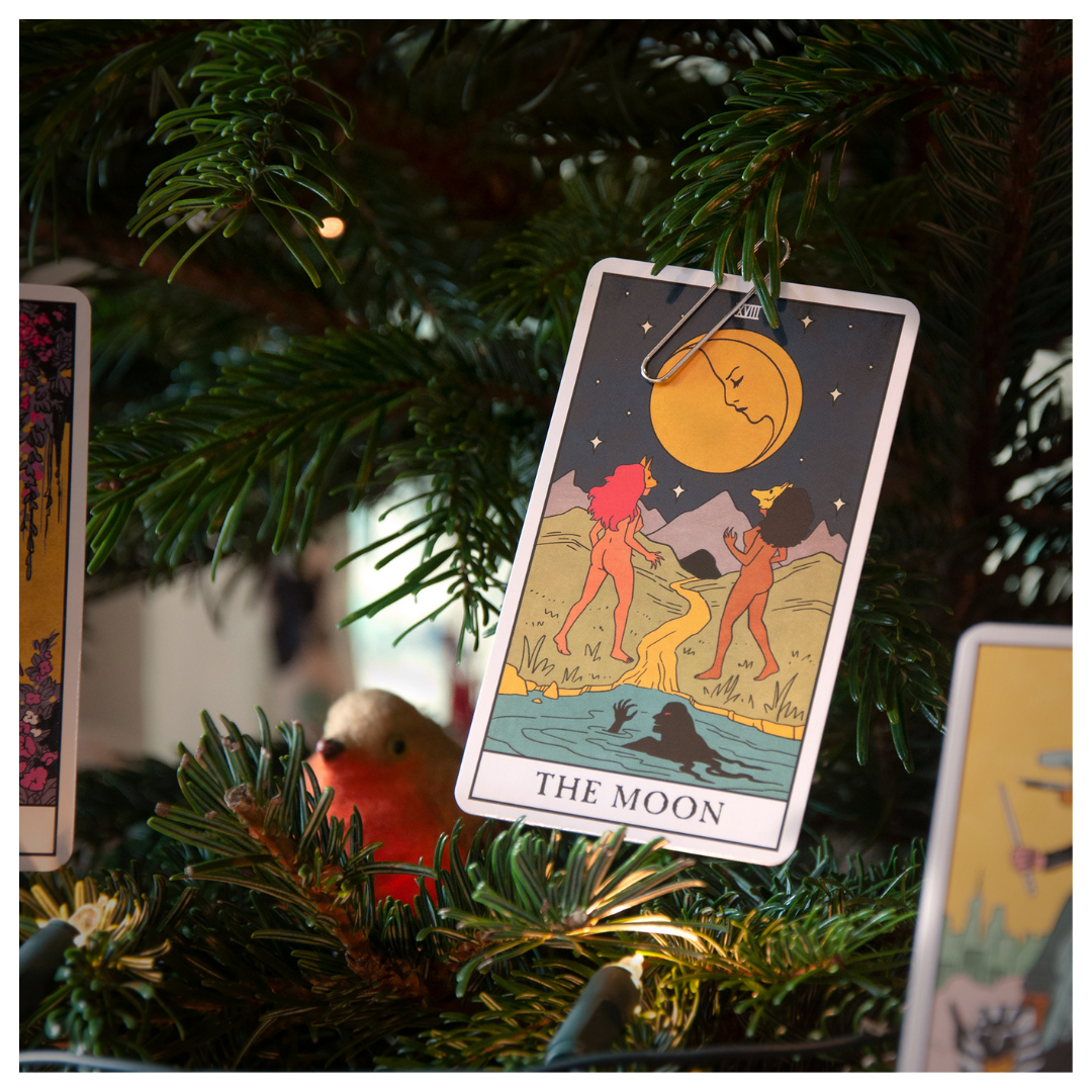 The Moon from Modern Witch Tarot hanging up on a Christmas tree